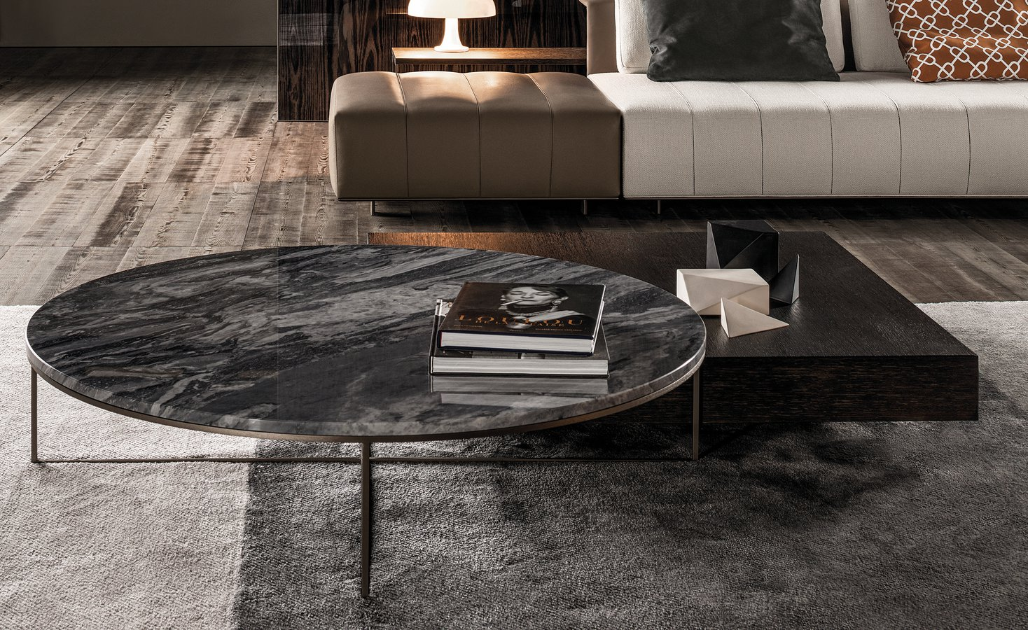 Calder bronze coffee table round by minotti ecc a series of new finishes contributes a fresh contemporary feel to the calder family that comprises many coffee tables and console tables available in geotapseo Images